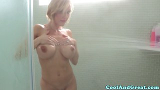 Busty milf masturbates in shower
