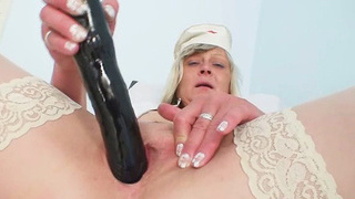 Filthy nurse milf Nada fucks herself with big dildo