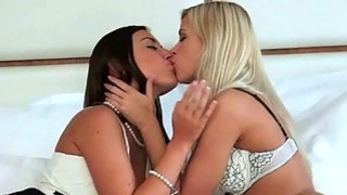 Cute blonde and hot brunette making lesbian love