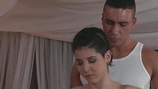 Oiled brunette banged by her masseur till ass jizz