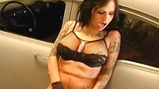 Tattooed Brunette Dildoing by the Car