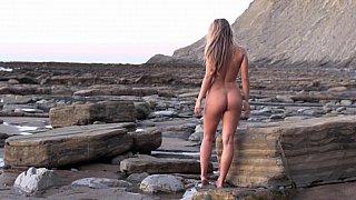 Nude babe morning walk at the ocean shore