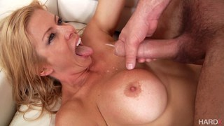 Busty MILF titfucked and creamed