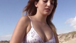 Brunette amateur getting nudeo n the beach