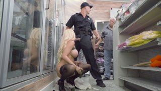 Blonde Luna Star sucks policeman's cock in a store