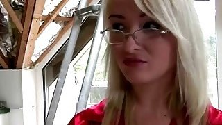 A very hot blonde teen with glasses sucks a cock of old construction worker