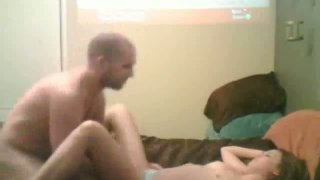 Bald dude is fucking his girlfriend in a missionary position. Homemade video