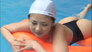 Bathing suit on young Japanese chick Aki Hoshino gets wet