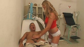 Sexual and hot blond doctor provides patient's dick with a blowjob